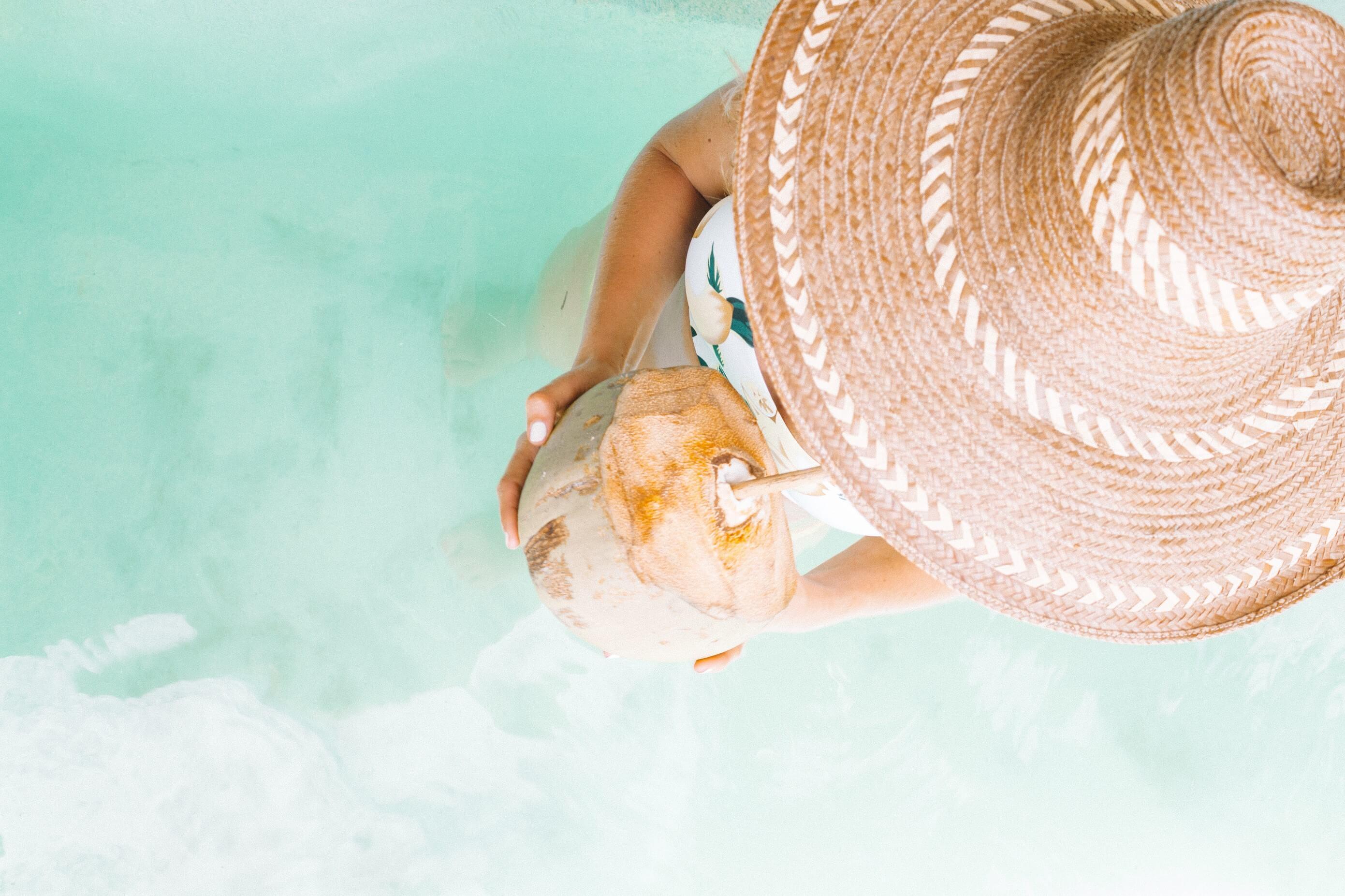 Curaçao Tech Meetups | Lady drinking coconut water